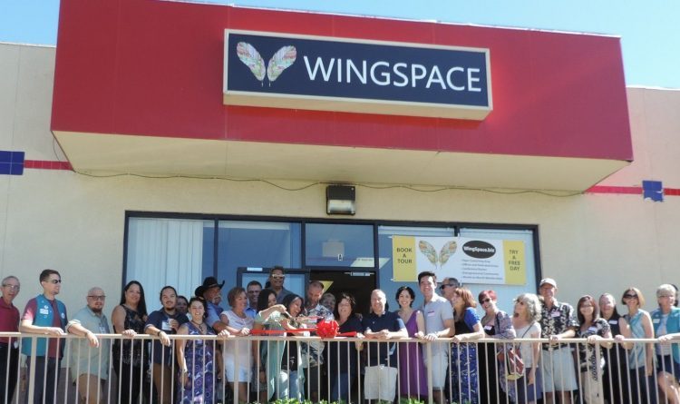 Entreprenuers are cutting ribbon in front of the Wingspace Coworking